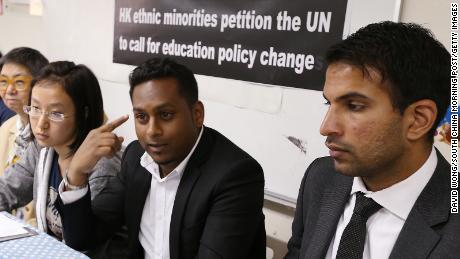 Members of the Hong Kong Unison, a nonprofit that helps ethnic minorities, petition the UN to call for education policy change in May 2014, citing racial discrimination.