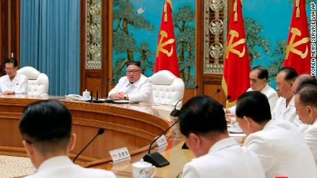 In this photo provided by the North Korean government, North Korean leader Kim Jong Un, second left in the background, attends an emergency meeting in Pyongyang on Saturday.
