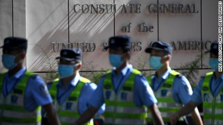Policemen march in front of the US consulate in Chengdu, southwestern China's Sichuan province, on July 26.