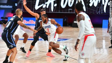 The NBA and the players' union say that no player tests positive for coronavirus the day before the season begins