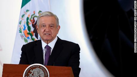 Mexican President Andres Manuel Lopez Obrador speaks during press conference, with the presidential plane in the background on July 27, 2020.