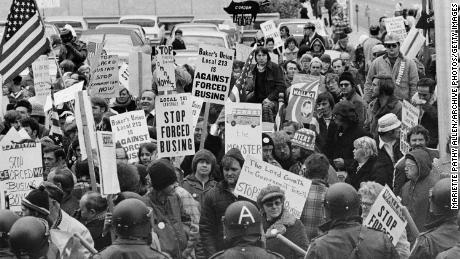 Demonstrators carry signs against forced school busing outside a convention of Democratic leaders in Louisville, Kentucky, on November 23, 1975.