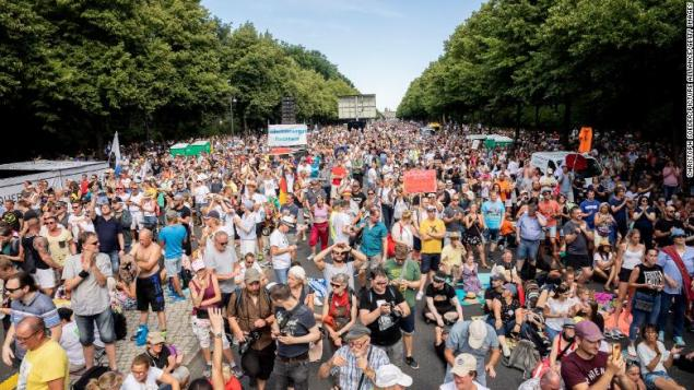 Protesters, mostly unmasked, attend a rally in Berlin against coronavirus restrictions.
