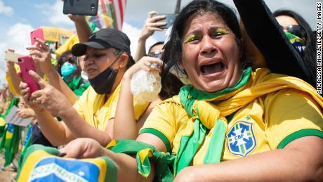 A supporter of Brazilian President Jair Bolsonarocries duringa demonstrationin favor of his governmentamidstthe coronavirus pandemic in front of Planalto Palace on May 24, 2020 in Brasilia, Brazil.