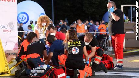 Medics attend to Jakobsen after the crash.