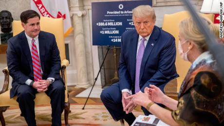 White House Coronavirus Response Coordinator Dr Deborah Birx, right, speaks as President Donald Trump, center, meets with Arizona Gov. Doug Ducey, left, in the Oval Office of the White House in Washington, Wednesday, August 5, 2020.