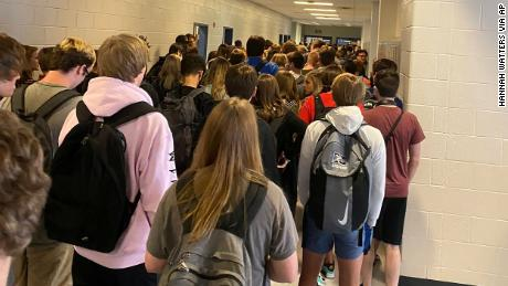 A school nurse in the district with the crowded hallway photo quit over a scarcity of Covid-19 precautions.