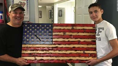 15-year-old boy is carving wooden flags to support 'forgotten heroes' during the pandemic