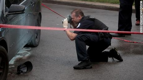 Police investigate the scene of a shooting in Chicago on July 21, 2020. Homicides in the city are up 33% in the first three months of the year compared to 2020, while shootings are up nearly 40% for the same period year-over-year.