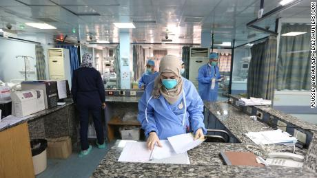 Health workers prepare quarantine rooms at the Al Mojtahed Hospital in Damascus, Syria, on 19 March.