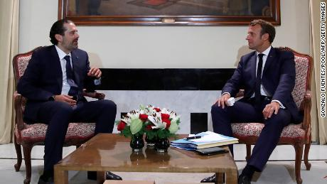 French President Emmanuel Macron meets former Lebanese Prime Minister Saad Hariri (L) at the Pine Residence, the official residence of the French ambassador to Lebanon, in Beirut, on August 31, 2020.