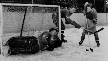 Didrikson (right) works out with the New York Rangers players Murray Murdock (center) and Andy Aitkenhead, goalie, in Madison Square Garden in New York City in 1933.