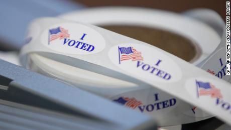 Michigan bans open carrying of guns at polling sites on Election Day