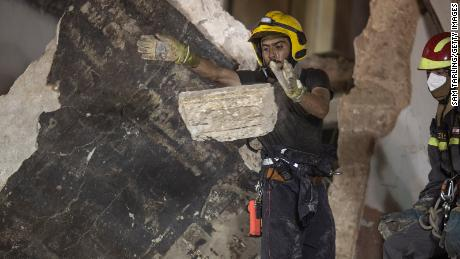 Rescue workers clear rubble from a destroyed building with the aim of finding a potential survivor on September 4, 2020 in Beirut, Lebanon.