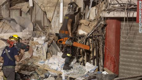 Rescue workers return to search a destroyed building with the aim of finding a potential survivor in the aftermath of the Beirut blast on September 4, 2020 in Beirut, Lebanon.