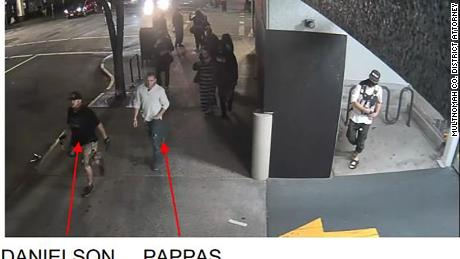 Photos taken from surveillance video shortly before the fatal shooting in Portland show Michael Reinoehl inside the entrance of a parking garage, just feet from Aaron Danielson.