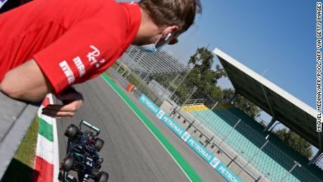 Sebastian Vettel watches rival Lewis Hamilton secure pole position.