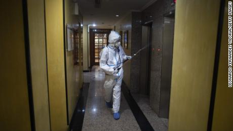 A member of the medical staff disinfected the corridors of a hotel where suspected Kovid-19 patients were staying in Caracas, Venezuela, on 20 July.