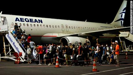On Wednesday night, a group of children boarded one of the three planes carrying 406 unaccounted minors from the burnt camp to mainland Greece.