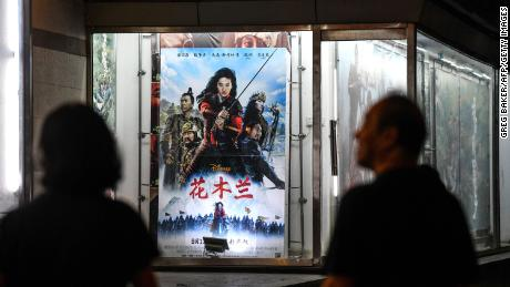People & quot;  Mulan & quot;  Outside a cinema in Beijing on Thursday.