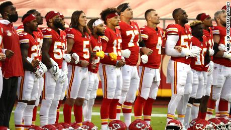 The Chiefs remained on the field while both anthems were played while the Texans went into the locker room.