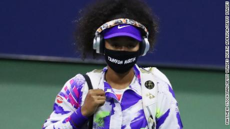 Osaka walks out wearing a mask with Martin's name before taking on Anett Kontaveit.