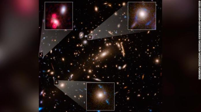 This Hubble Space Telescope image shows massive galaxy cluster called MACS J1206. Within this cluster are distorted images of distant background galaxies. They look like arcs and smears.
