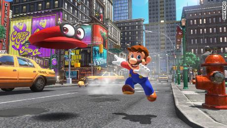 """In """"Super Mario Odyssey,"""" Mario explores various worlds and can use his hat to transform into enemies."""