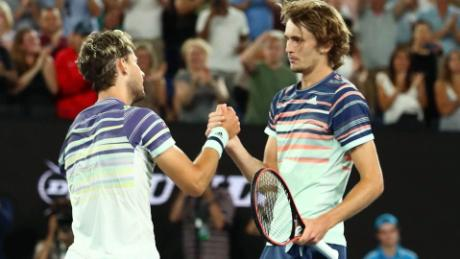 Thiem and Zverev meet at the net following the Austrian's victory.