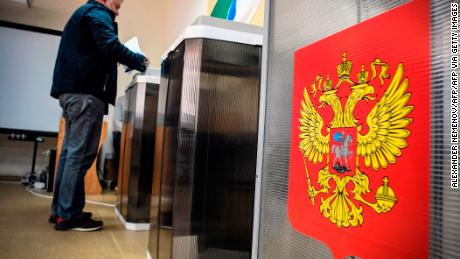 On September 13, 2020, a man votes at a polling station in Novosibirsk, Russia.