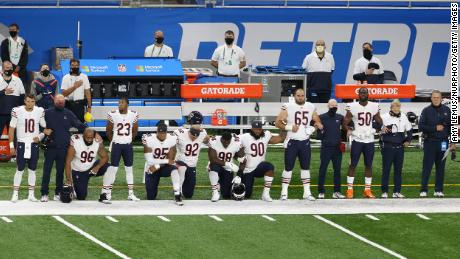 Chicago Bears players kneel during the National Anthem before the first half of an NFL football game against the Detroit Lions  in Detroit, Michigan USA, on Sunday, September 13, 2020.