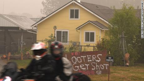 """A sign reads """"Looters Get Shot"""" outside a residence in Molalla, Oregon, in Clackamas County."""