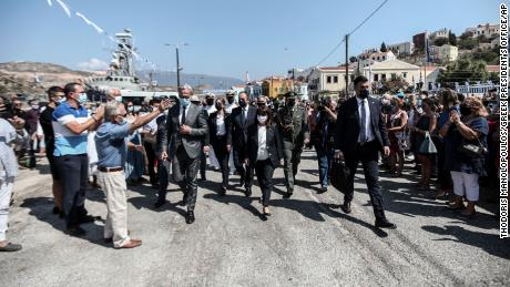 Greece's President Katerina Sakellopoulou, center, is delighted by residents during a visit to Kastorizo on Sunday.