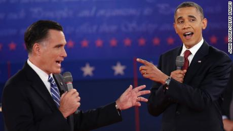 Republican presidential candidate Mitt Romney  and US President Barack Obama talk over each other as they answer questions during a town hall style debate at Hofstra University October 16, 2012 in Hempstead, New York.