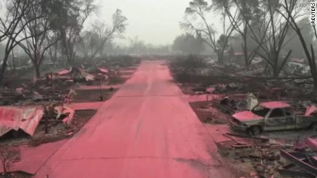 Red fire retardant blanketed the destroyed streets and homes of Talent, Oregon, after wildfires swept through the city.