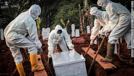 A coffin infested with a coronavirus virus is buried in the city of East Jakarta, Indonesia.