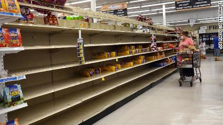 The shelves were emptied by a storm of people overtaking Sally in Alabama.