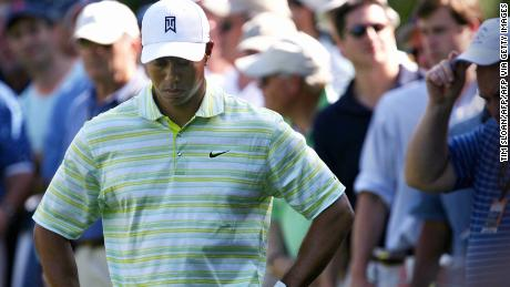 Woods hangs his head after hitting it into the rough on the 15th hole during the opening round of the 2006 U.S. Open.