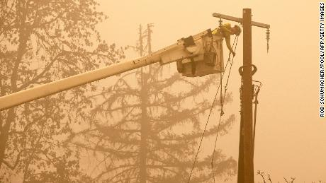 Workers continued to repair the power system after flames from the Beechy Creek Fire burned through fishermen's Bend Recreation Site in Mill City, Oregon.