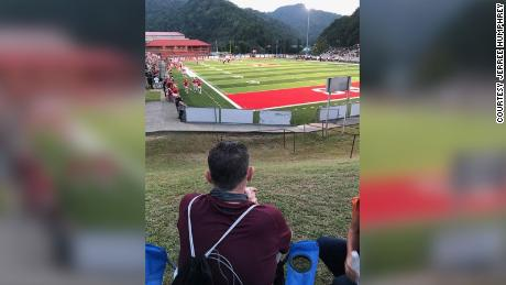 Sullivan watches the game from a hillside next to Haywood Field in Belfry, Kentucky.