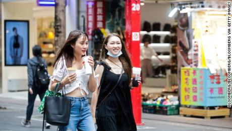 Pedestrians walk with their bubble tea drinks in the Ximending shopping district in Taipei, Taiwan, on July 30, 2020.