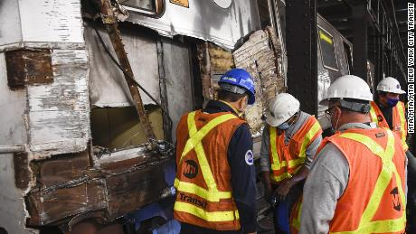 A train derailed on a subway platform in Manhattan Sunday. No passengers were injured.
