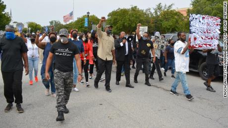 Protesters march in downtown Sylvania, Georgia, on September 19, 2020 over the shooting of Julian Lewis.