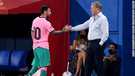 Messi shakes hands with Barca coach Ronald Koeman after he is substituted during the pre-season friendly match between FC Barcelona and Girona at Estadi Johan Cruyff on September 16, 2020.