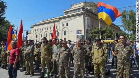 Servicemen are pictured in Yerevan, Armenia, on Sunday, the day the Armenian government imposed martial law and general mobilization after clashes with Azerbaijan.