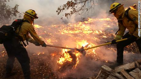 Marin County firefighters battle the Glass Fire on Sunday, September 27, in Calistoga, California.