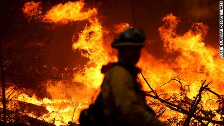 A Marin County firefighter battles the Glass Fire on Sunday, September 27, in Calistoga, California.