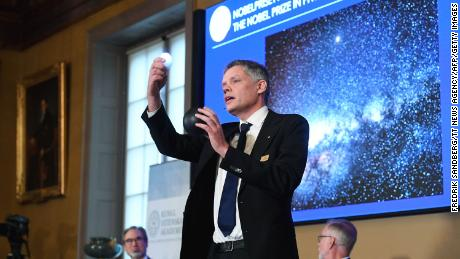 Ulf Danielsson, member of the Royal Swedish Academy of Sciences, speaks at a news conference following the announcement in  Stockholm, Sweden, on October 6.
