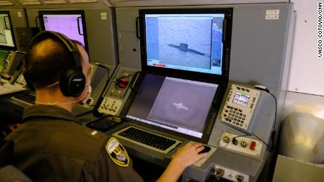 A US Navy service member uses the P-8A's camera to track a Russian Kilo-class submarine as it sails through the Black Sea.