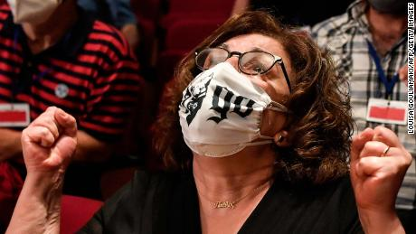 Magda Fyssa, the mother of murdered singer Pavlos Fyssas, reacts in court following the verdict on October 7.